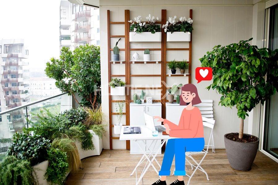 Sân vườn tại ban công là nơi lý tưởng để làm việc, thư giãn tại nhà