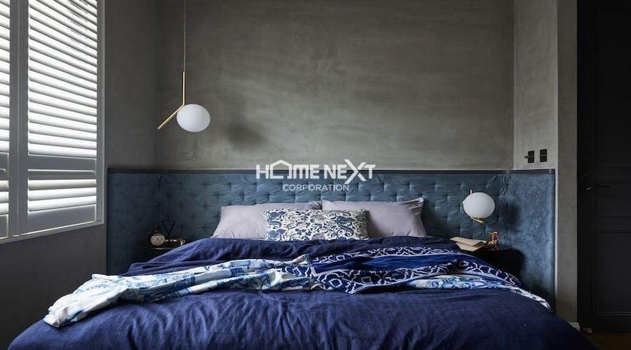 Không gian phòng ngủ với thiết kế màu xanh nổi bật tương tự phòng khách