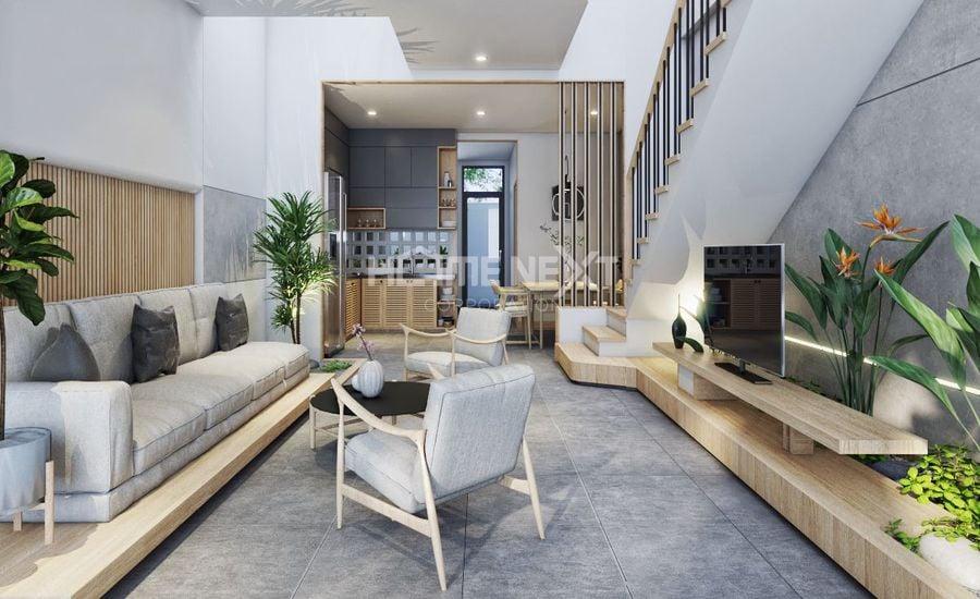 Tầng 1 với thiết kế phòng khách hiện đại với những mảng xanh tươi mới